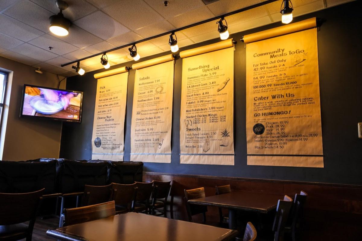 Huge paper menus hanging on the wall