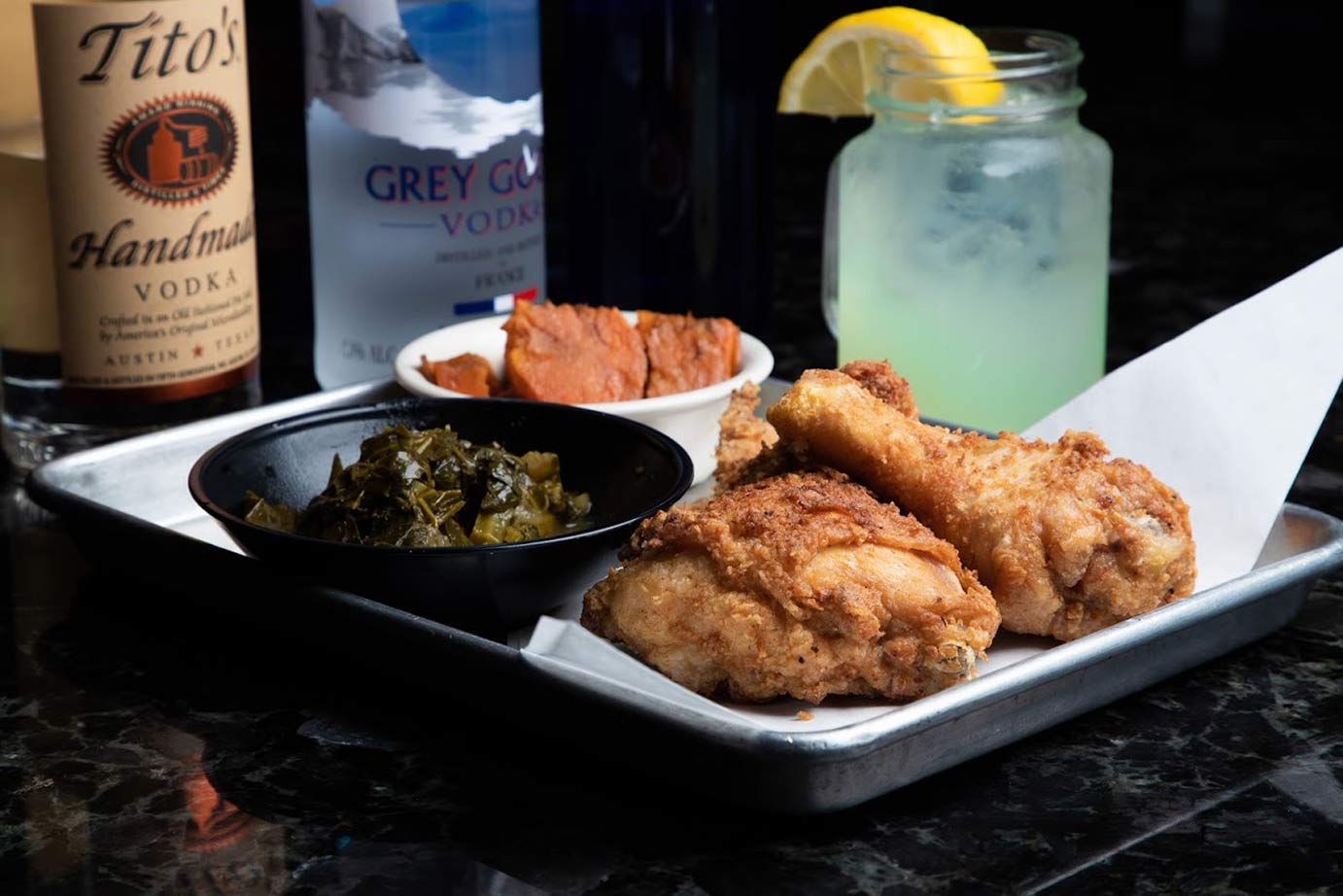 image of a fried chicken meal with a lemonade