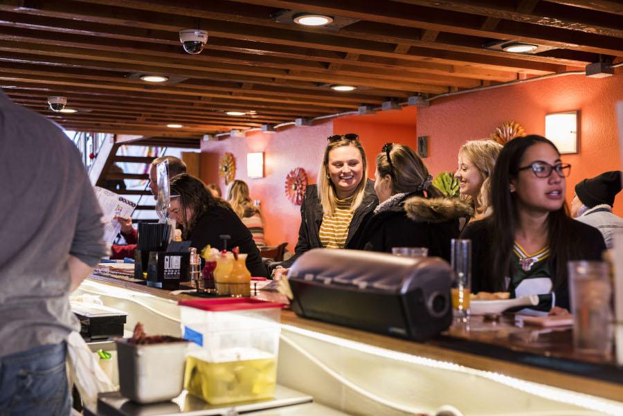 Bar area, bar patrons sitting