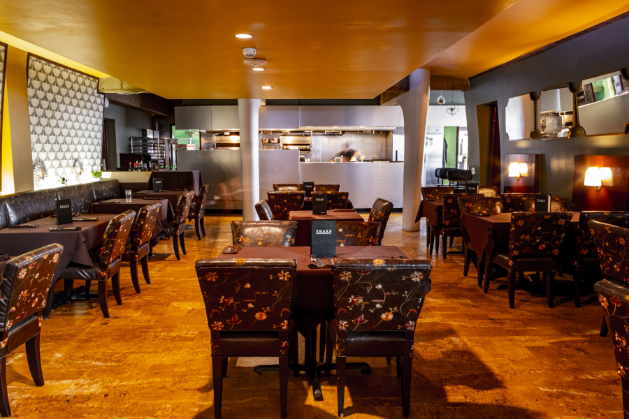 Traxx restaurant interior, sitting area, leather chairs with flower ornaments