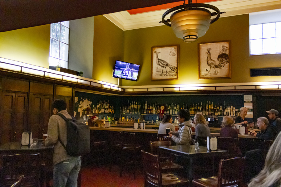 Traxx bar, sitting area, bird paintings, TV screen