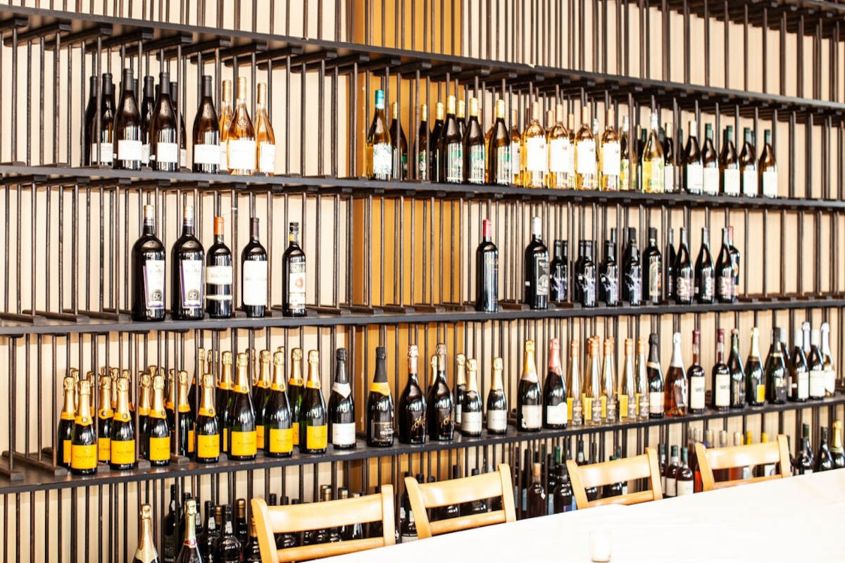 Different types of wine and champagne on shelves