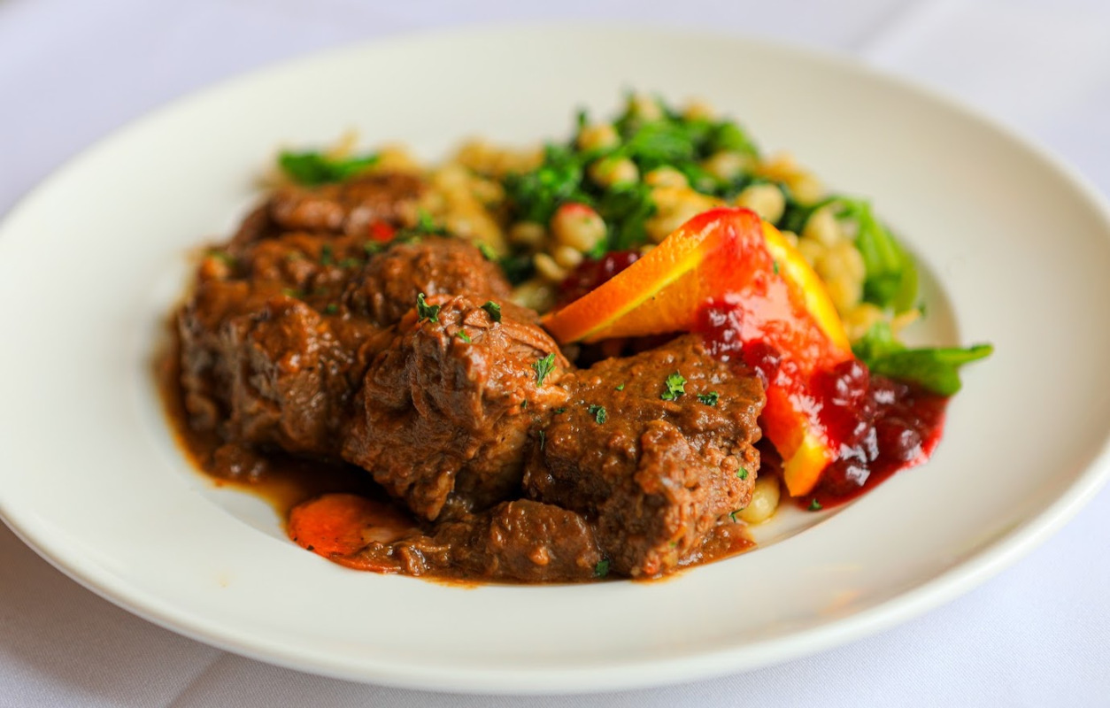 Grilled meat with sauce, vegetables on the side