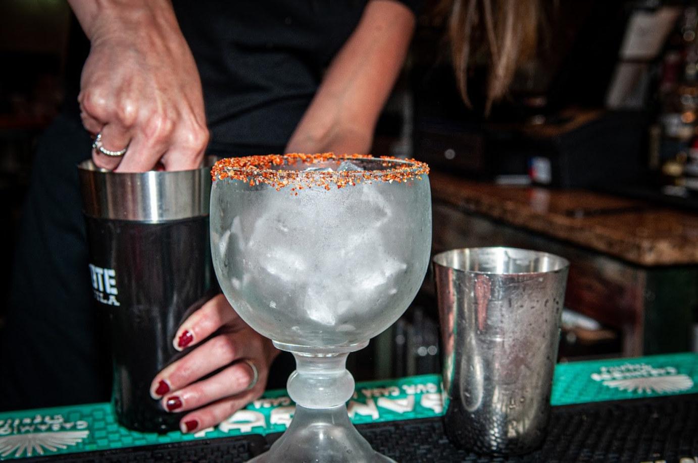 Employee making cocktail