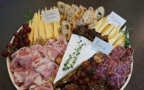 Smoked meat, fruit, cheese and sliced bread