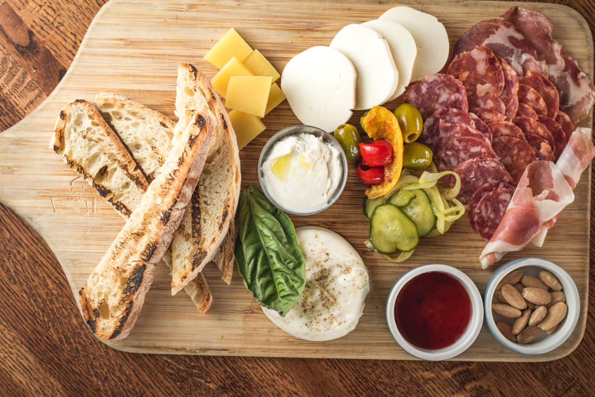 Snacks, smoked meat, dips, cheese and salad